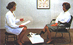 A person sits while recieving an ultrasound bone density scan