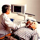 Image showing an ultrasound exam being performed.
